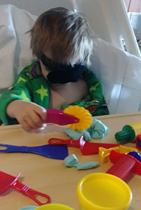 Jude playing with Playdoh after disc insertion