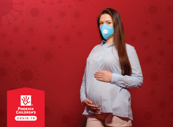 pregnant with a mask on